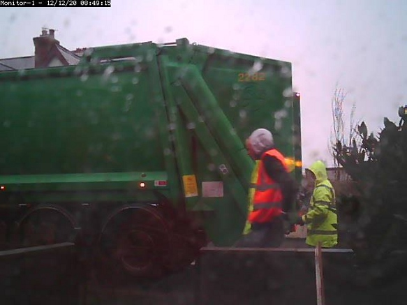 Image of bin men and a dust cart.