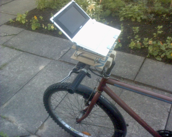 Image of a netbook on bike handlebars